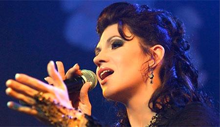 Дина мигдал преподает в школе вокала